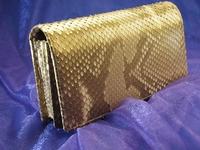 金の錦蛇の革で作った200万円入る財布